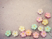 Colorful pastel artificial flower on recycled paper background, Royalty Free Stock Image