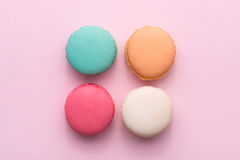 Colorful pastel cake macaron or macaroon on pink background from Royalty Free Stock Image