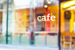 Colorful and pastel coffee shop and text cafe in front of mirror Stock Images
