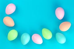 Colorful pastel easter eggs on blue stock photo