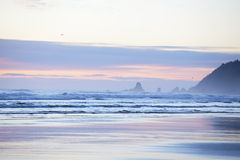 Colorful pastel hues in sky over Cannon Beach, Oregon Stock Photos