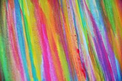 Colorful pastel hues, strokes of brush, backgrounnd. Pastel vivid strokes of brush, yellow, pink, green red, orange hues are placed on burnt watercolor abstract stock images