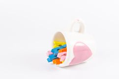 Colorful pastel of wooden clothespins in coffee cup  isola Stock Photography