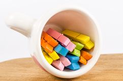 Colorful pastel of wooden clothespins in coffee cup on woo Royalty Free Stock Photos