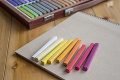 Colorful pastels and a sketchbook Royalty Free Stock Photography