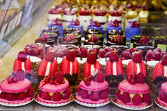 Colorful pastries cake. Colorful French pastry on the shelf for sale Royalty Free Stock Photo