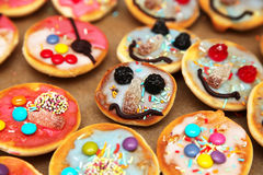 Colorful pastry for kids. Funny pastry with faces for kids (birthday party Stock Photo