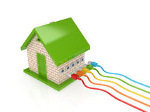 Colorful patch cords and small house. Stock Photo