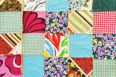 Colorful patchwork fabric. Several patchwork patterns of colorful fabric royalty free stock images