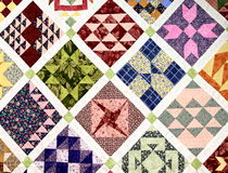 Colorful patchwork. Handmade patchwork quilt with square patches Royalty Free Stock Images