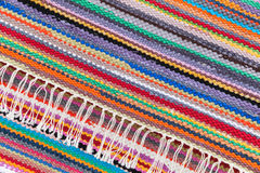 Colorful patchwork rug with striped pattern. Colorful abstract patchwork rug with striped pattern, background photo texture Stock Photos