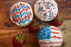 Patriotic cupcakes for July 4th celebration. Colorful patriotic decorated cupcakes for summer celebration.  American flag themed cupcakes Royalty Free Stock Photography