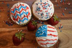 Patriotic cupcakes for July 4th celebration. Colorful patriotic decorated cupcakes for summer celebration.  American flag themed cupcakes Stock Image