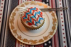 Patriotic cupcakes for July 4th celebration. Colorful patriotic decorated cupcakes for summer celebration.  American flag themed cupcakes Royalty Free Stock Images