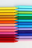 Colorful pattern of crayons in a white background. Colorful pattern of color pencils cold and hot colors Stock Image