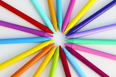 Colorful pattern of crayons in a white background. Colorful pattern of color pencils doing a circle in a white background Royalty Free Stock Photo