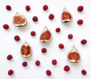 Colorful pattern of fig fruits and raspberries. Flat lay, top view Stock Images