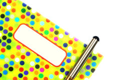 Colorful pattern notebook with pen Royalty Free Stock Photo