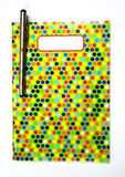 Colorful pattern notebook with pen Stock Images