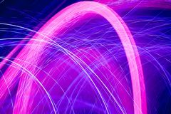 Neon abstract pattern. Colorful pattern of pink and blue dynamic neon lines. Modern background. Art concept of lighting effects royalty free stock photos