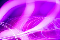 Neon abstract pattern. Colorful pattern of purple and pink dynamic neon lines. Modern background. Art concept of lighting effects royalty free stock photo