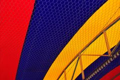 Colorful patterned fabric ceiling. Colorful patterned fabric tensile roof structure ceiling closeup stock image
