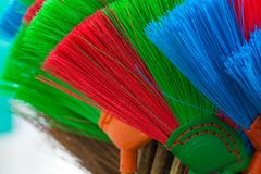 The colorful and patterns of plastic brooms. Royalty Free Stock Image