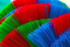 The colorful and patterns of plastic brooms. Royalty Free Stock Images