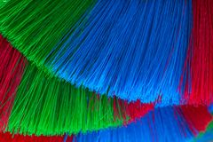 The colorful and patterns of plastic brooms. Royalty Free Stock Photo