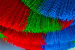 The colorful and patterns of plastic brooms. Stock Images