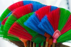 The colorful and patterns of plastic brooms. Stock Image