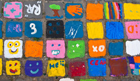 Colorful pavement. Colorful street art on the bricks from pavement Stock Image