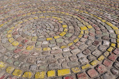 Colorful paving stones. Forming decorative spiral Royalty Free Stock Image