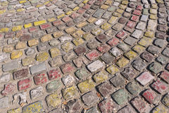 Colorful paving stones. Background pattern of colorful weathered paving stones Stock Image