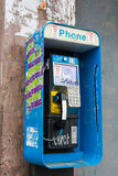 Colorful Pay Phone in a City Stock Images