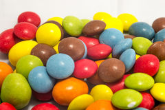 Colorful peanuts and smarties Royalty Free Stock Photo