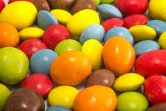 Colorful peanuts and smarties stock image
