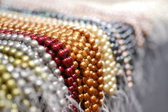 Colorful pearl strands. Closeup of many colors of freshwater pearl strands Stock Photography