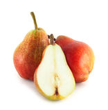 Colorful pears. Two and half colorful pears isolated on white background Stock Photography