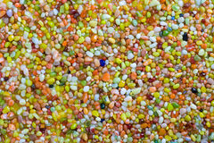 Colorful pebble background. A background of small multi-colored beach pebbles Royalty Free Stock Images