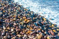 Pebbles in a shore of an island. Colorful pebble`s in the shore of patmos island beach,athens greece Royalty Free Stock Photography