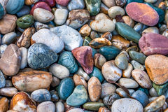 Colorful pebbles background. Close up of colorful pebbles on a beach Stock Photo