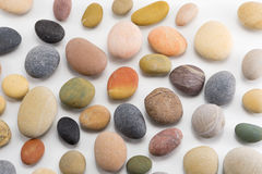Colorful pebbles on white background. Colorful pebbles on the white background Royalty Free Stock Photo