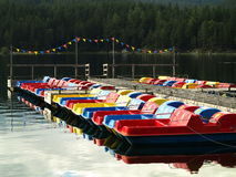 Colorful pedal boat row at jetty Stock Photo