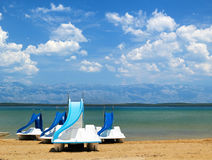 Colorful pedalos on a beautiful tropical beach. Bright sunny day stock photo