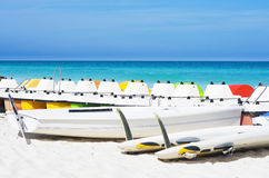 Colorful pedalos docked at shore. Colorful pedalos docked at the shore of the tropical beach of Santa Maria in Cuba royalty free stock photos