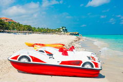 Colorful pedalos and kayaks at the beach of Varadero in Cuba Stock Photos