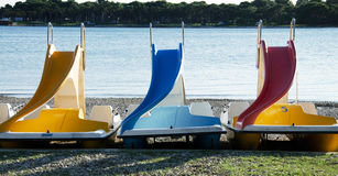 Colorful pedalos. On a sea beach in the summer stock photo