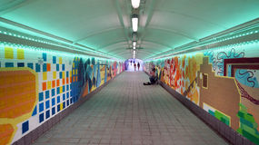 A colorful pedestrian tunnel in Singapore Stock Images
