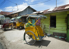 Colorful Pedicab, Ambon, Indonesia. Also called a becak, these are a quite common form of transportation traversing the streets of Ambon City, Indonesia Stock Photography